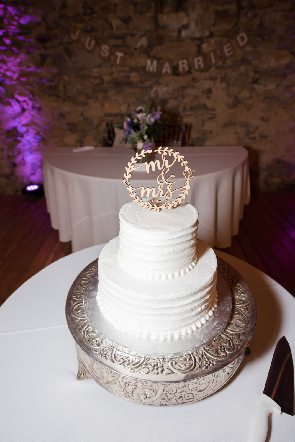 white rustic wedding cake with wood topper