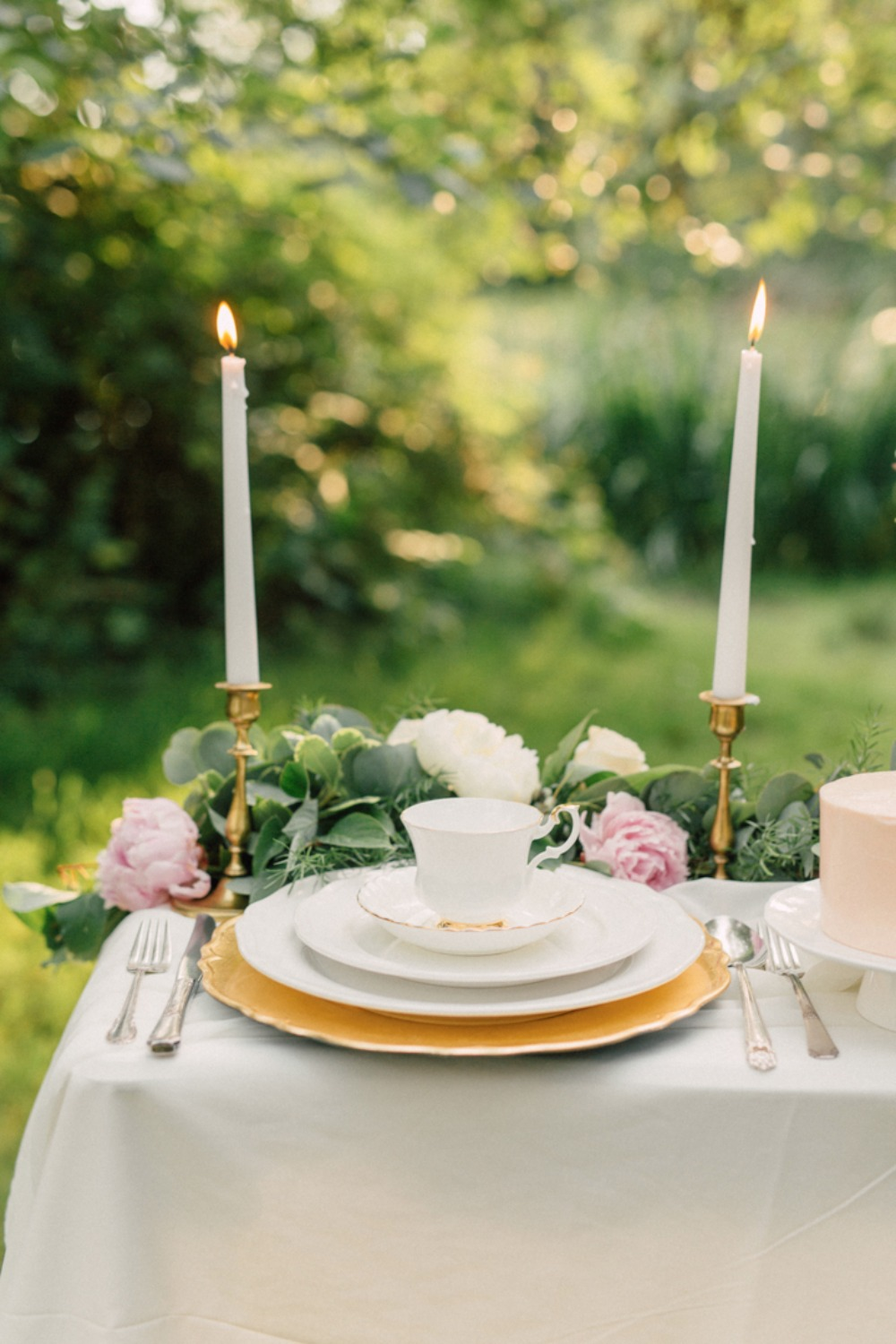 Garden table setting with candle sticks