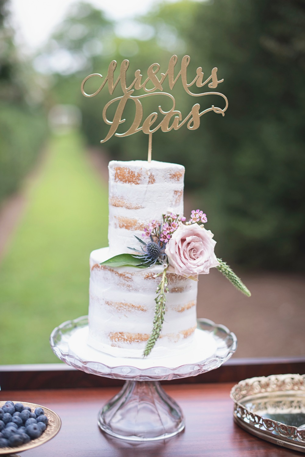 Two tier nearly naked cake