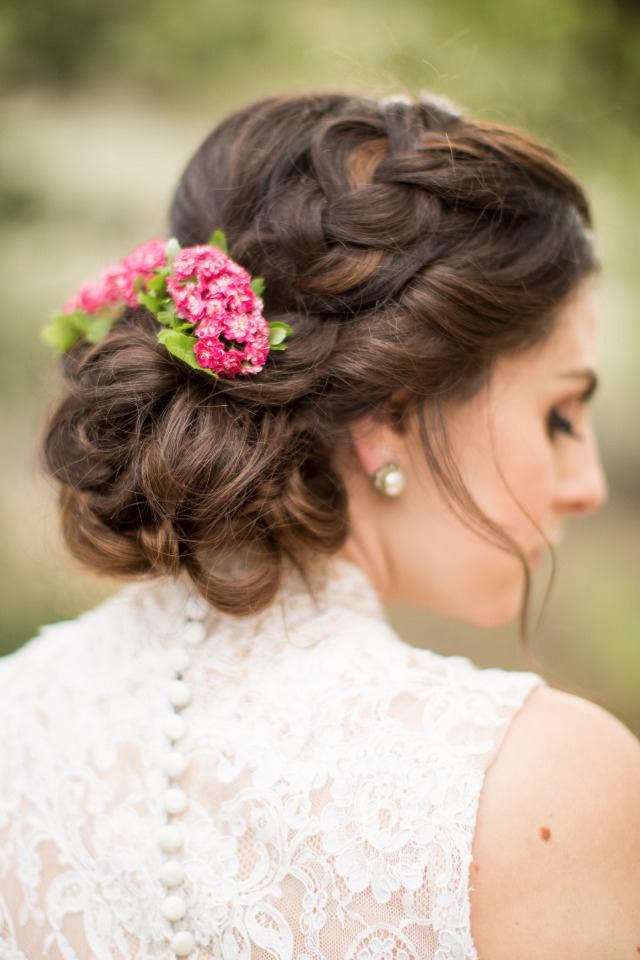braided wedding updo with flower accents