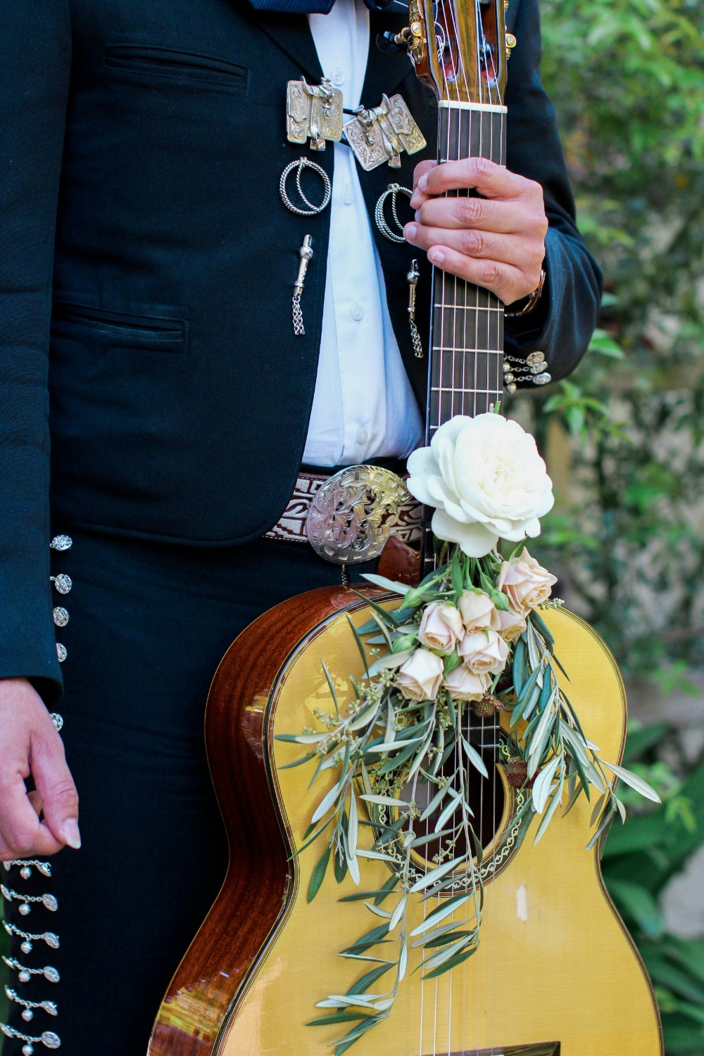 Wedding mariachi guitar with florals