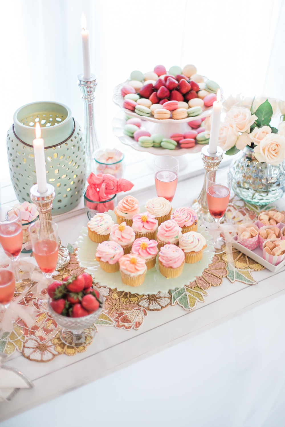 pink and mint dessert table with cupcakes