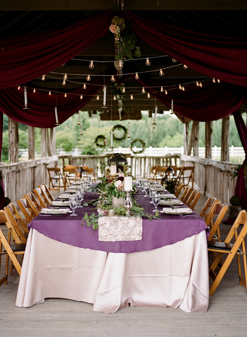 Elegant purple and maroon reception with hanging candles