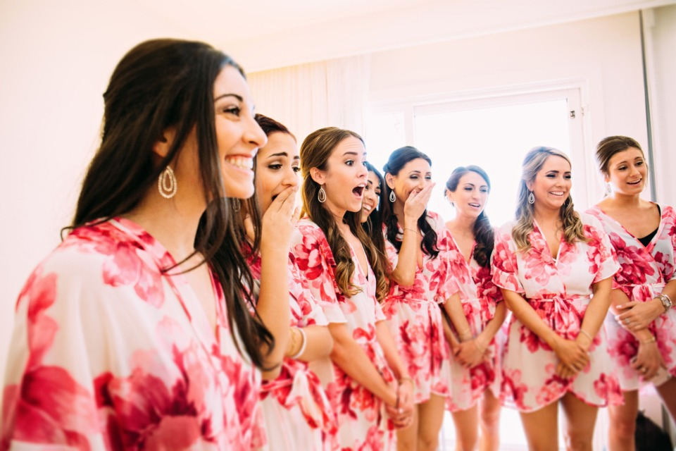 surprising her bridesmaids with a first look at the wedding dress