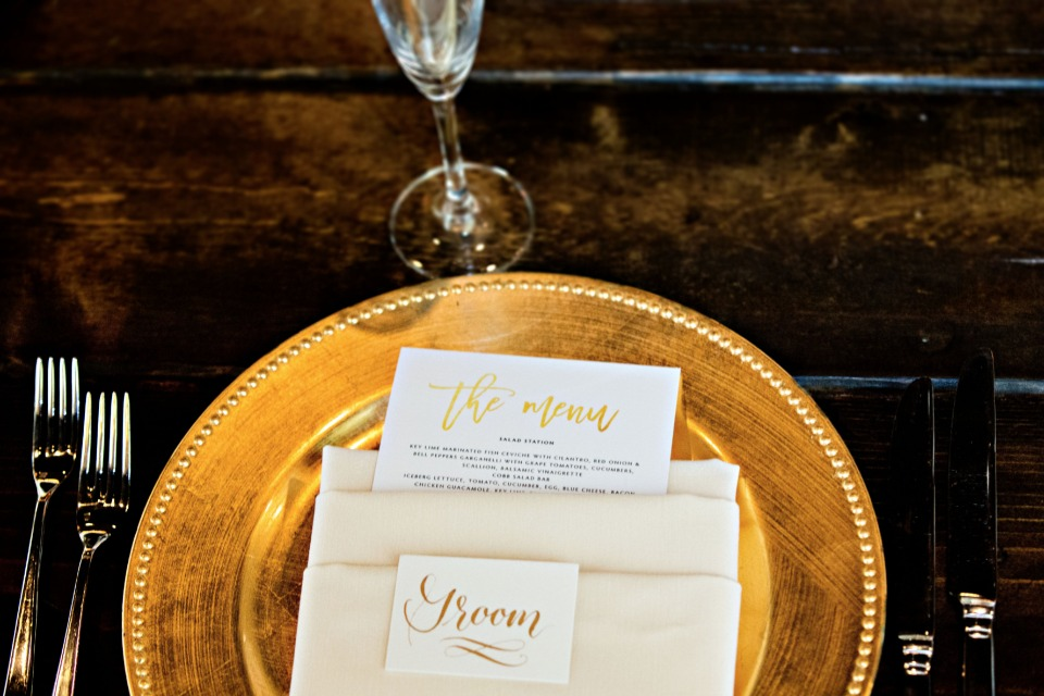 gold charger and gold wedding menu