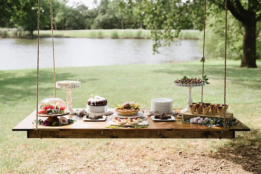 Hanging dessert table idea for an outdoor wedding