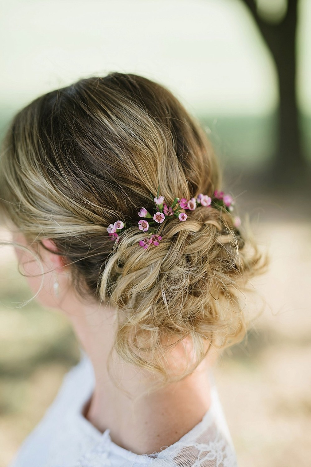 Wedding updo with florals