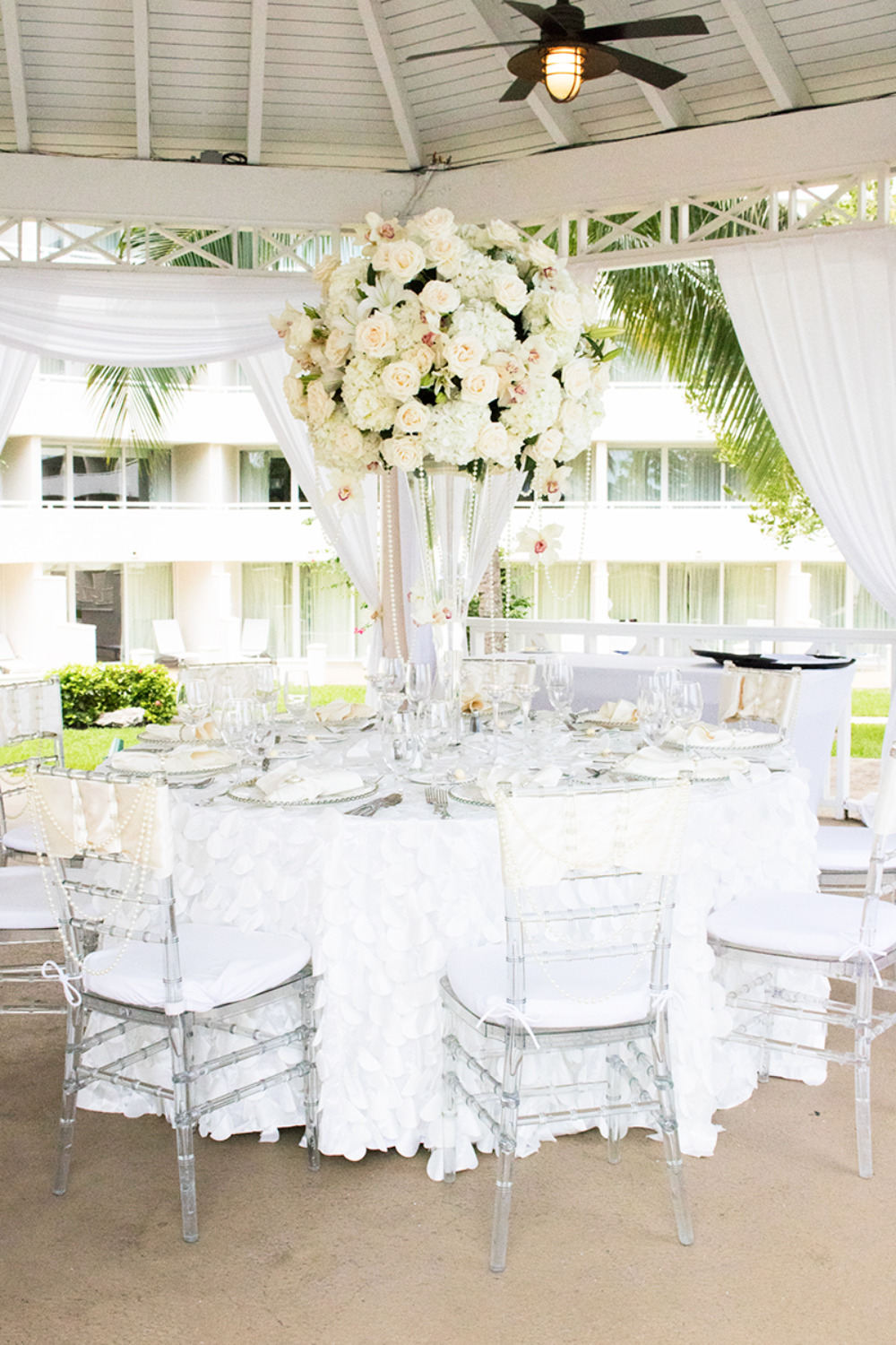 pretty white wedding reception layout