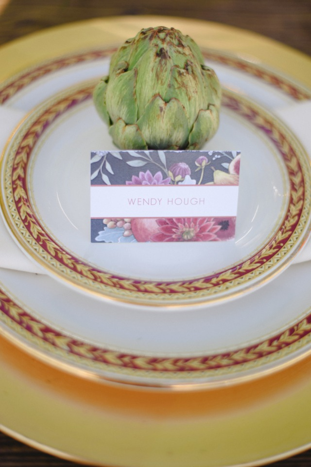 gold and red wedding china with floral escort card