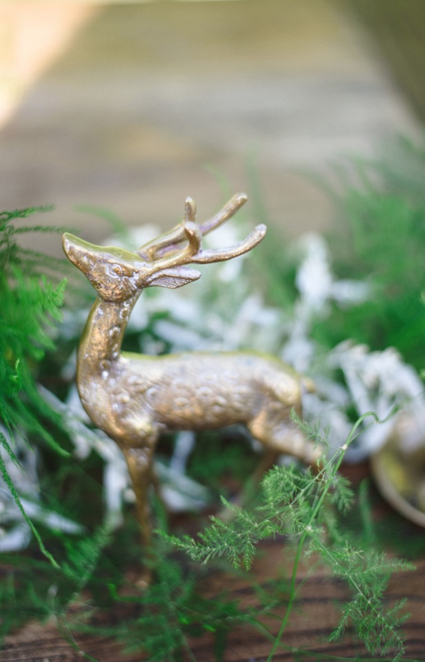 silver forest animals add a hint of whimsy to centerpiece