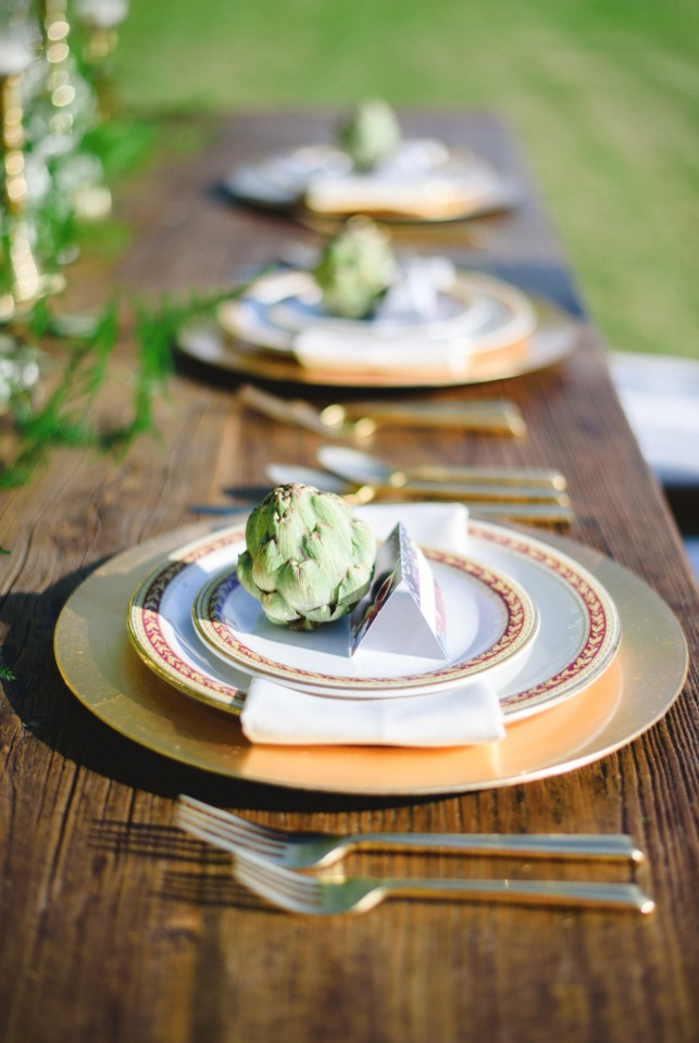 gold wedding chargers and artichoke place card holders