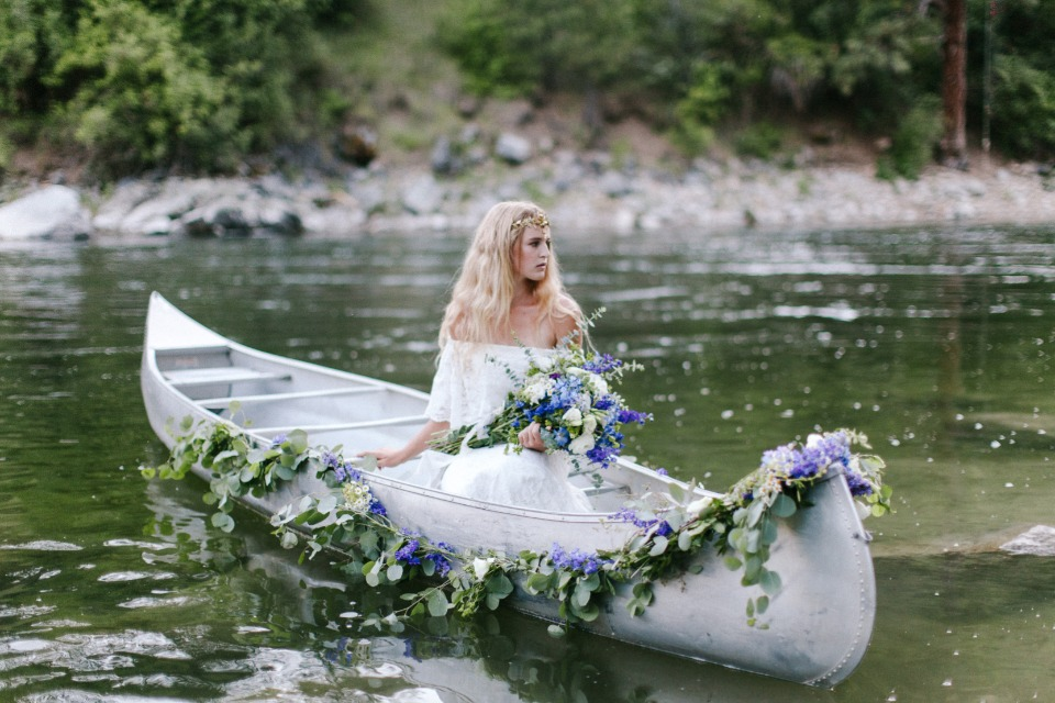 here comes the bride in a canoe