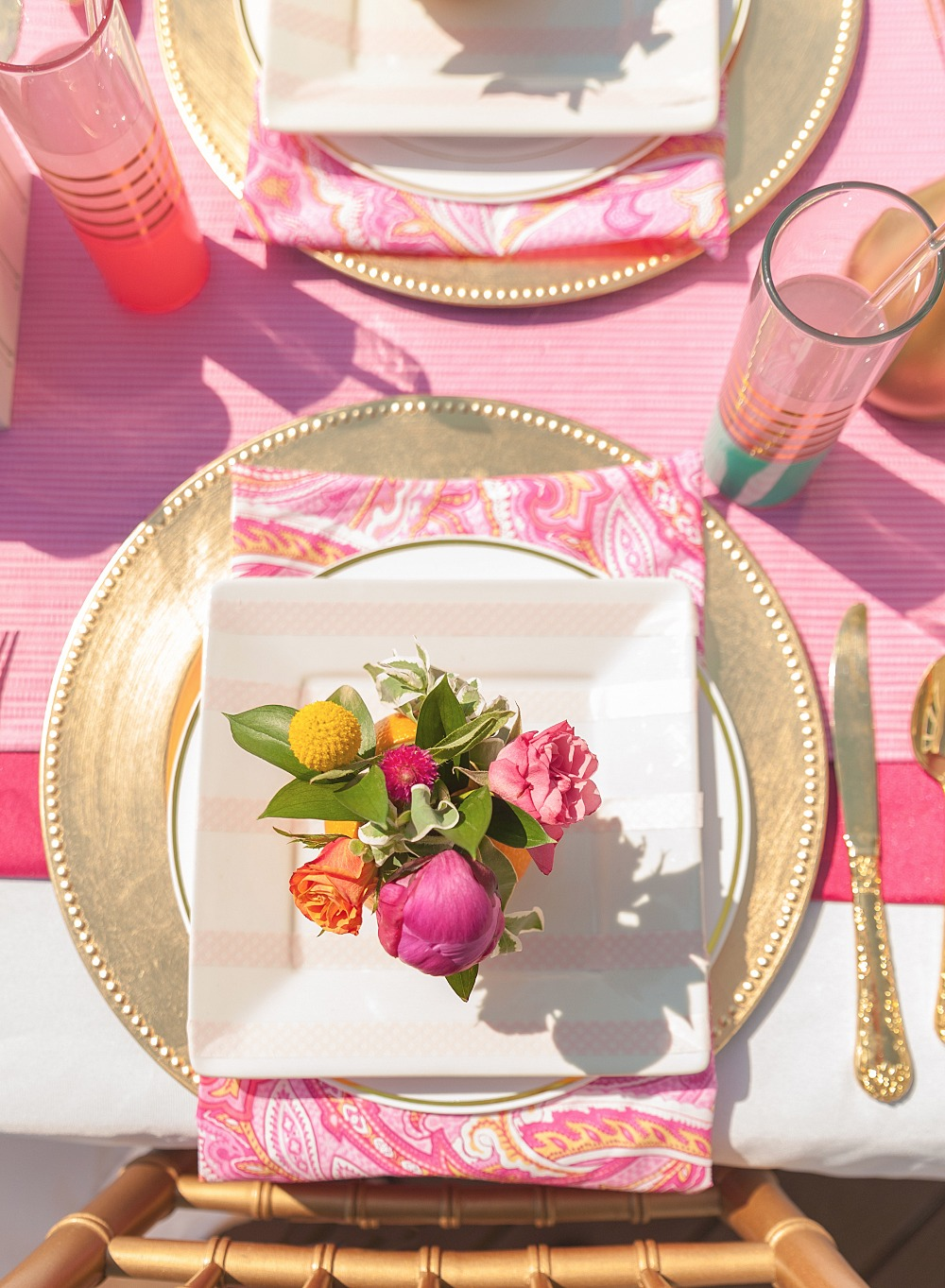 Fresh bridal shower place setting idea with gold details