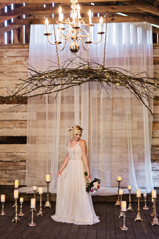 rustic chandelier and candle lit wedding decor