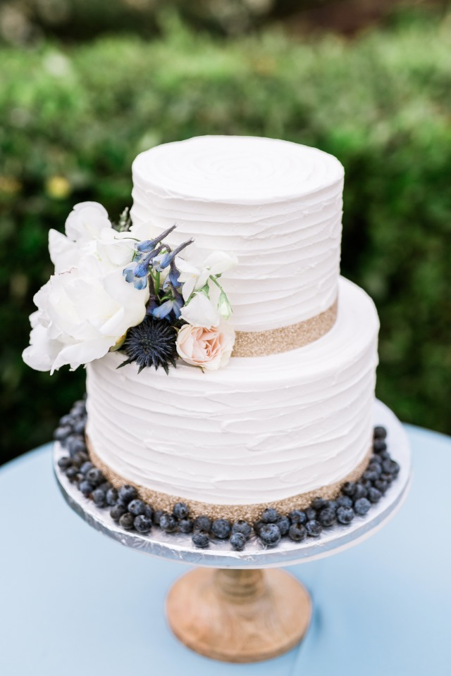 gold and blueberry wedding cake