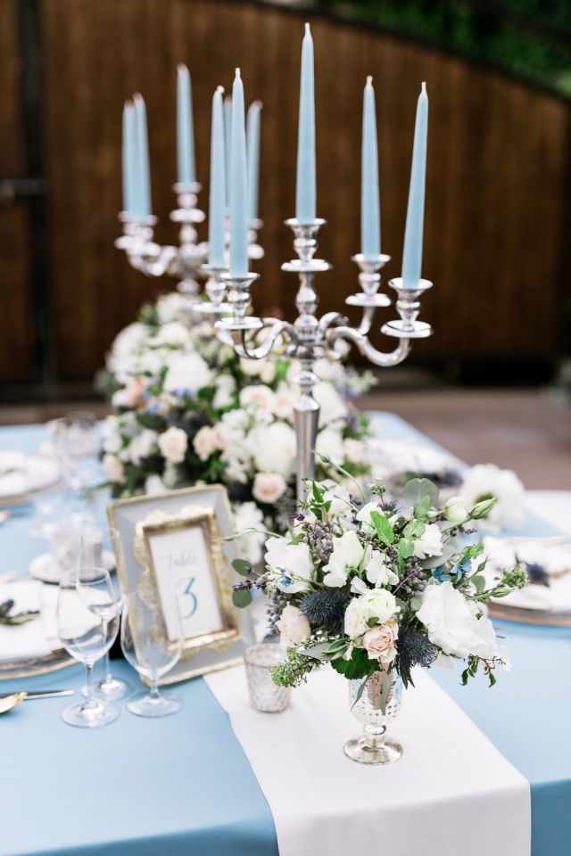 framed table number and silver candelabras