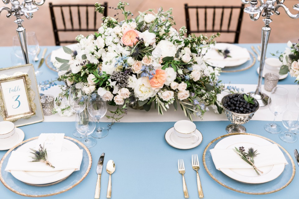 soft peach white and blue wedding centerpiece