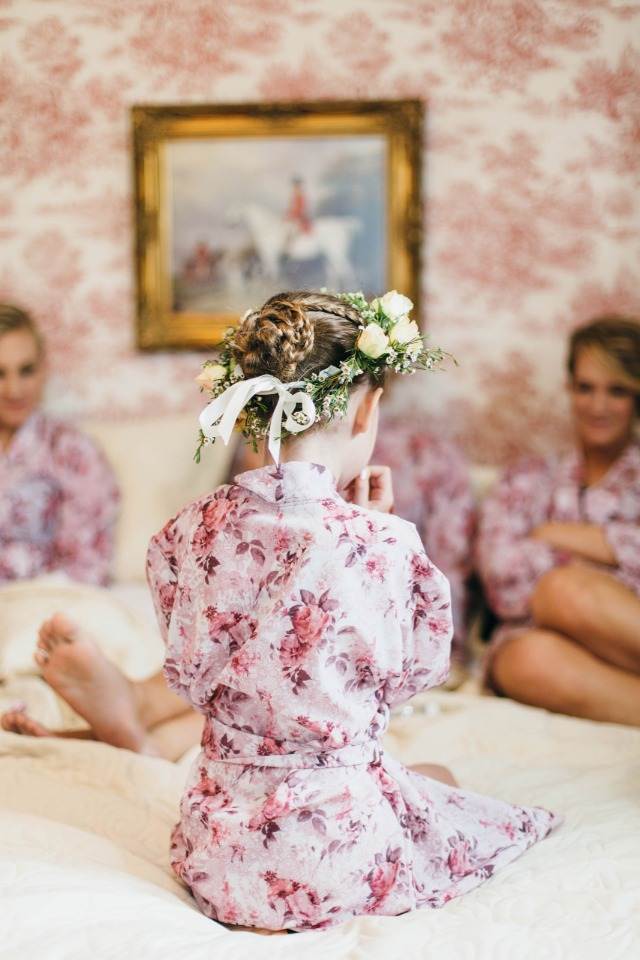 cute little flower girl in her getting ready robe