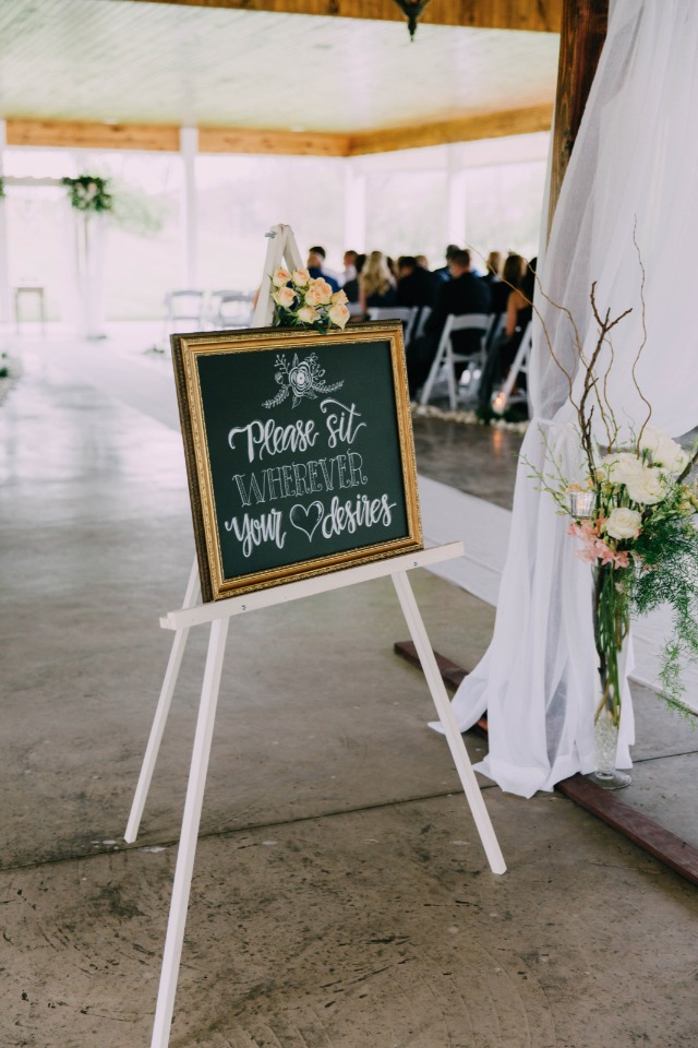 please sit where your heart desires wedding sign