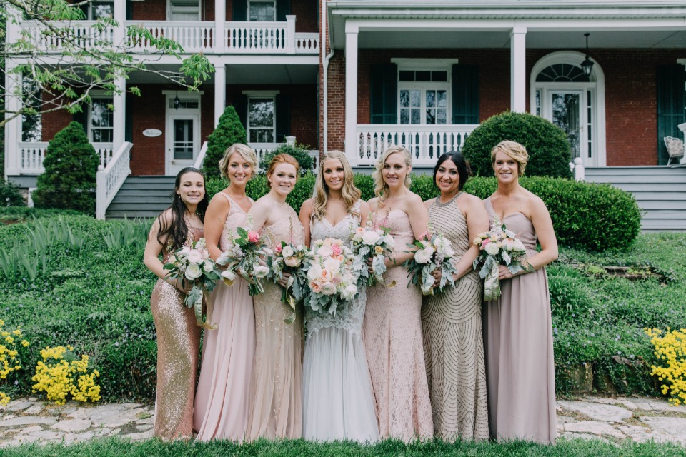 mismatched bridesmaid dresses in pink and champagne