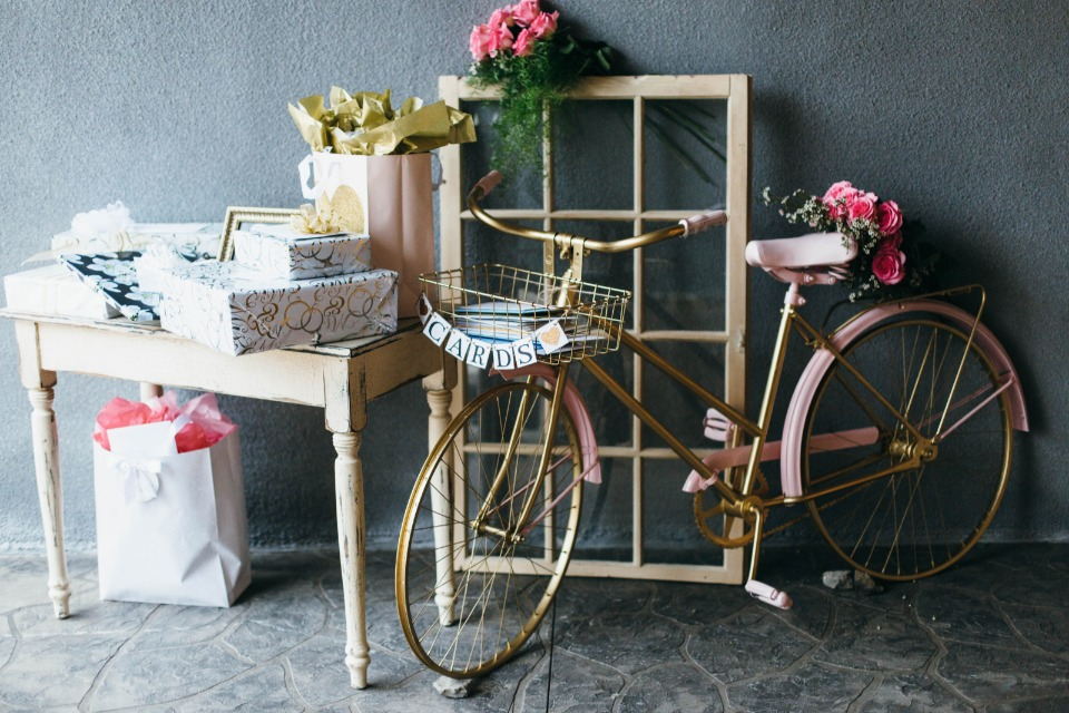 gift and card table with vintage bicycle