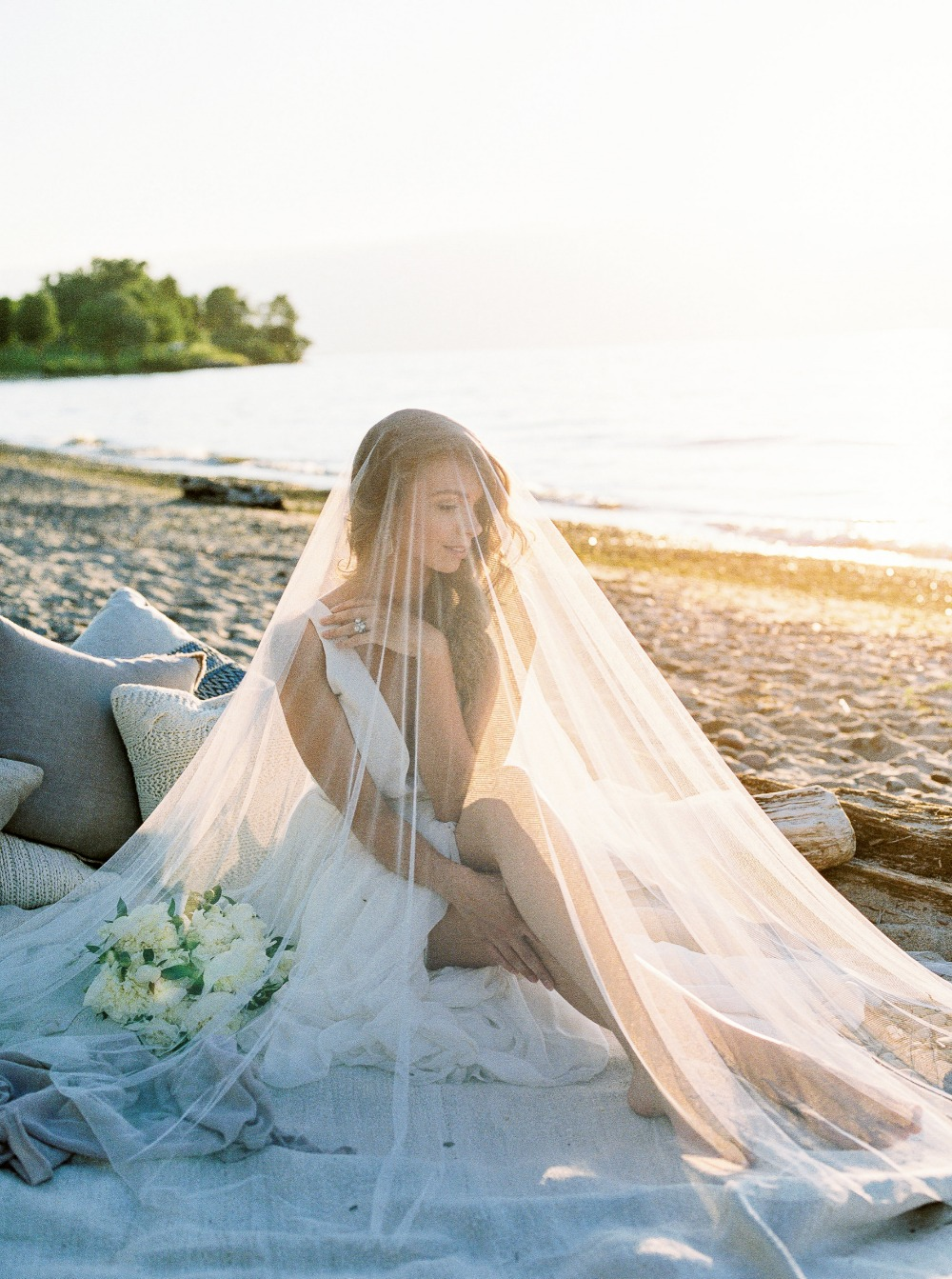 Beach bridal portrait with veil