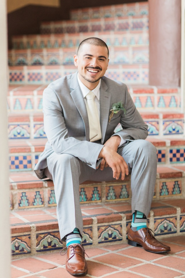 dapper groom in grey and ivory with funky socks
