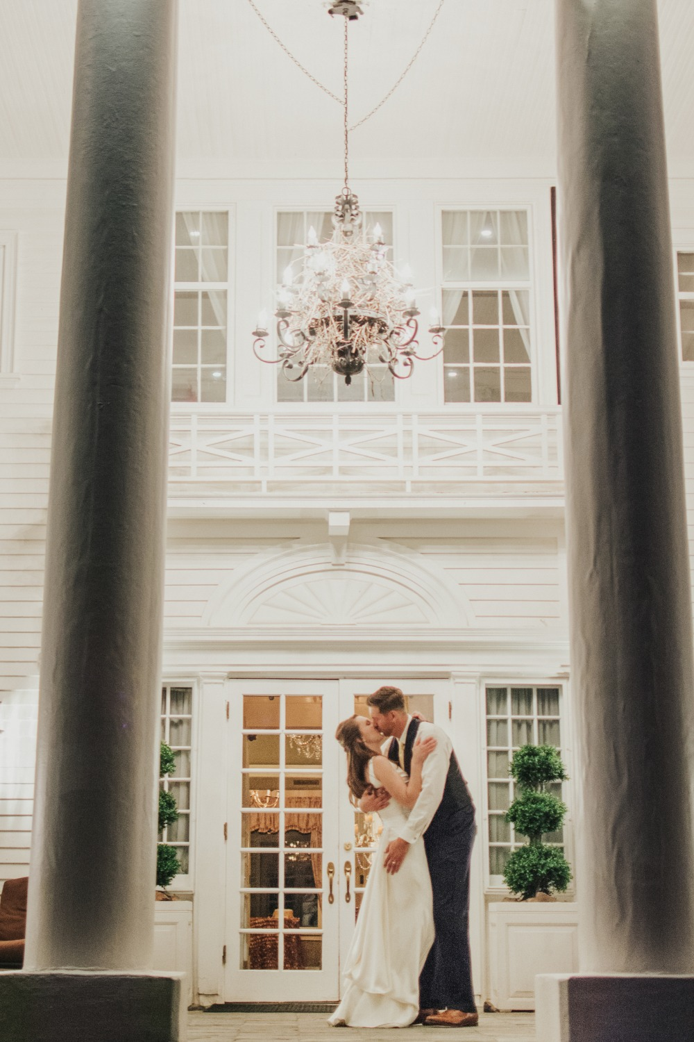Kiss under a chandelier