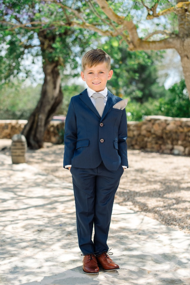 adorable little ring bearer in navy blue