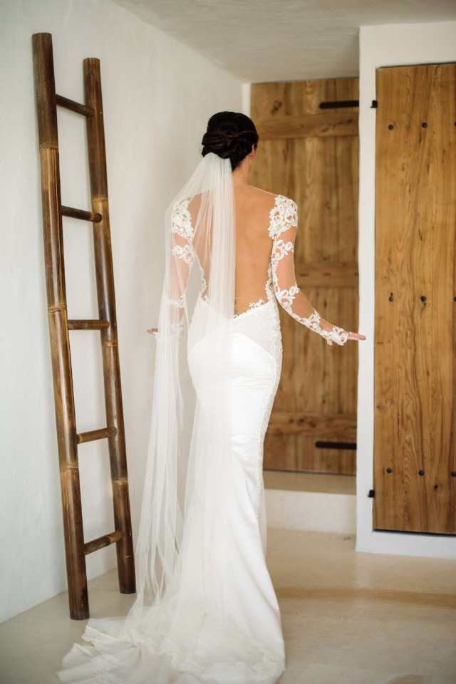 back showcasing wedding dress with long lace sleeves