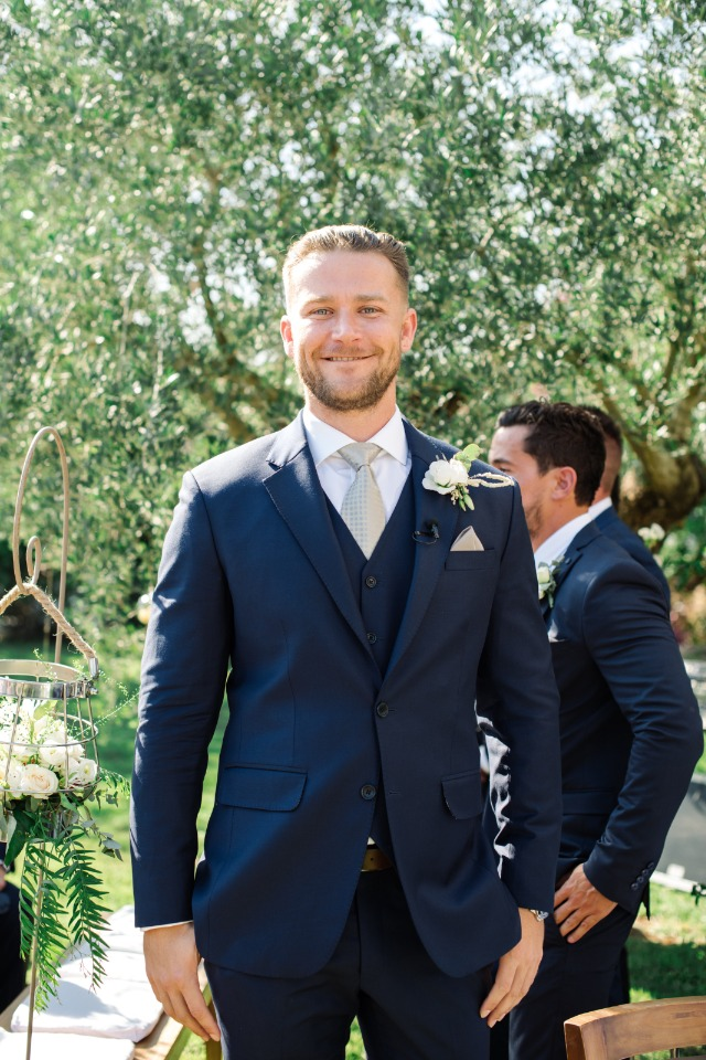 groom in three piece navy suit and grey tie