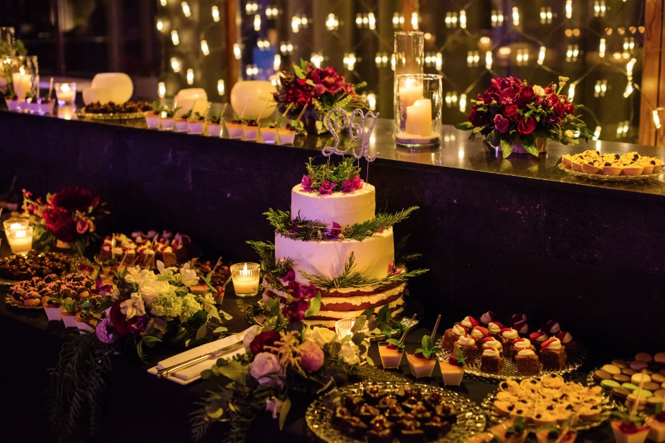 so many sweets options at this glam candle lit cake table