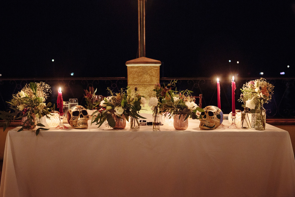 wedding sweetheart table with Mexican painted skulls