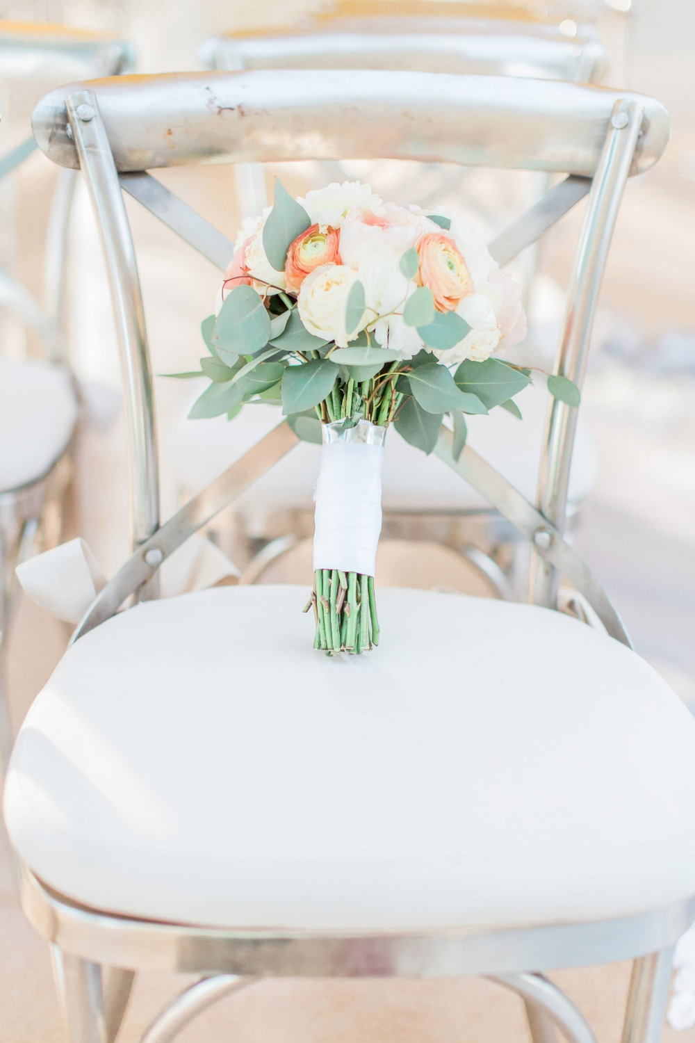 Silver chairs and bouquet