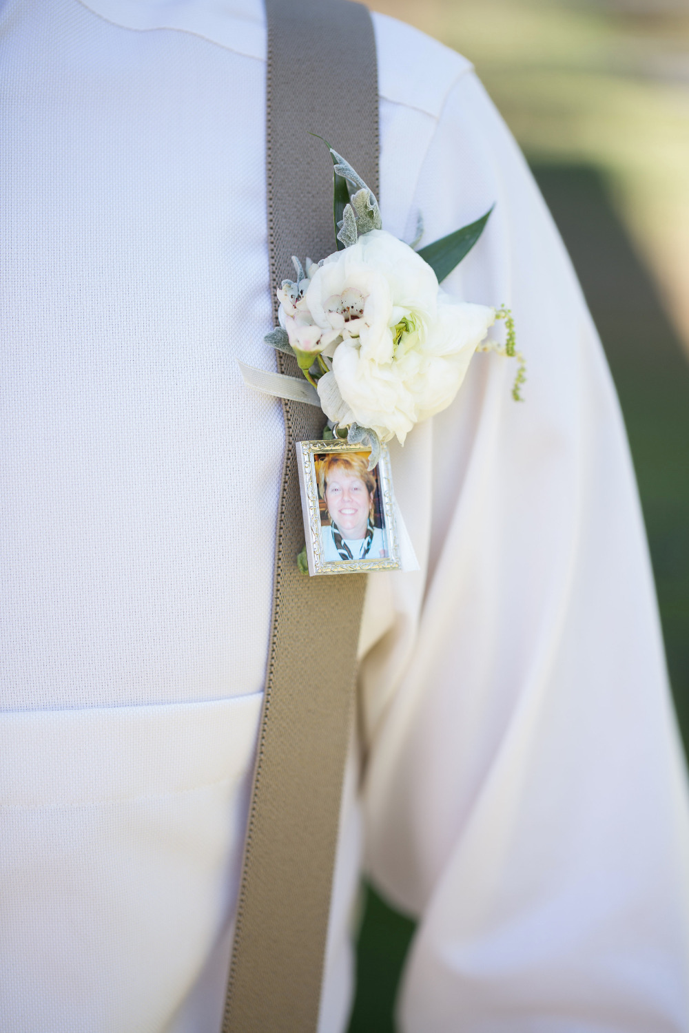 white wedding boutonniere with photo charm