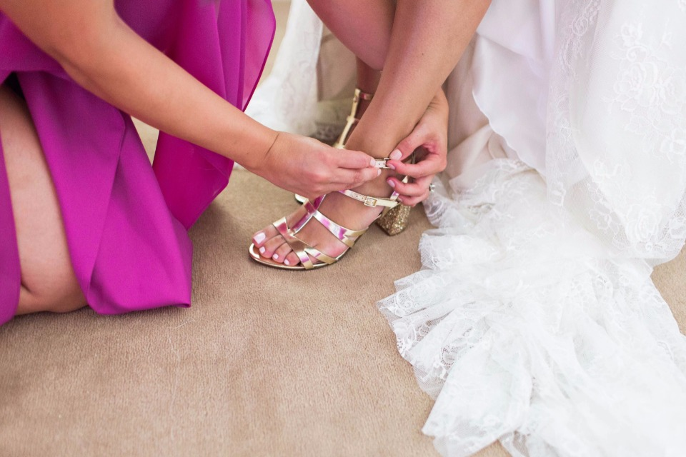 getting wedding ready in gold shoes