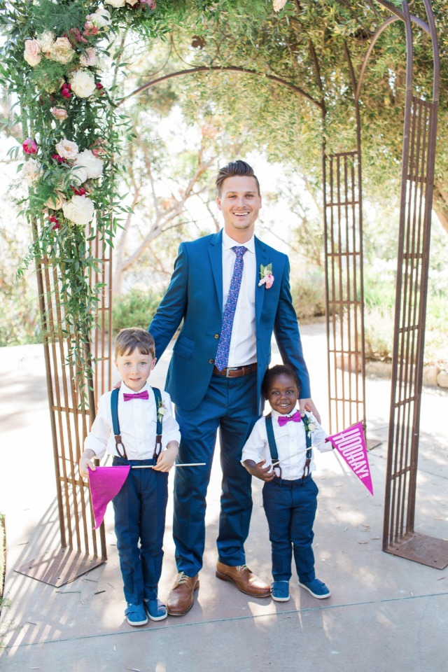 groom in blue with cute ring bearers