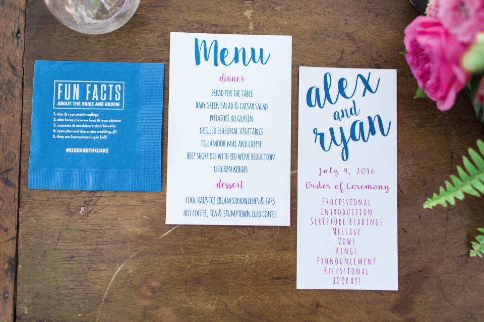 blue and pink menu cocktail napkin and program
