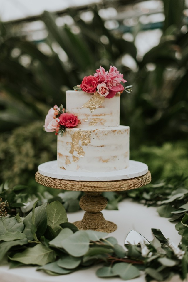 gold leaf wedding cake topped with pink flowers