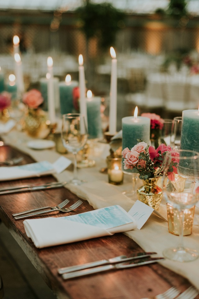 gold and pink with pops of teal table decor