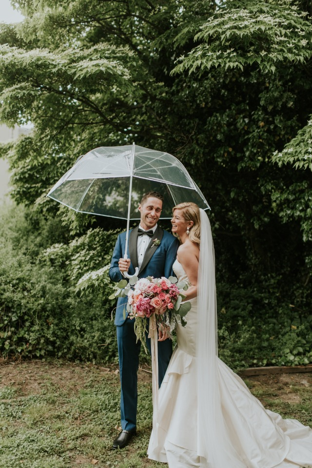 cute rainy day wedding photo