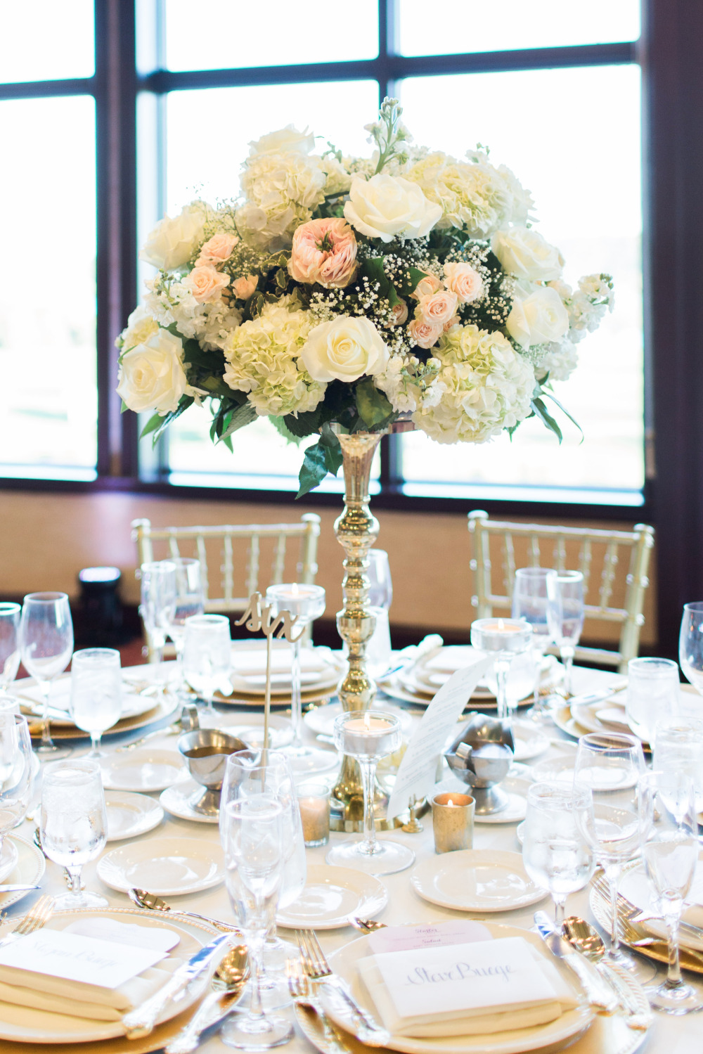 white and pink tall wedding centerpieces