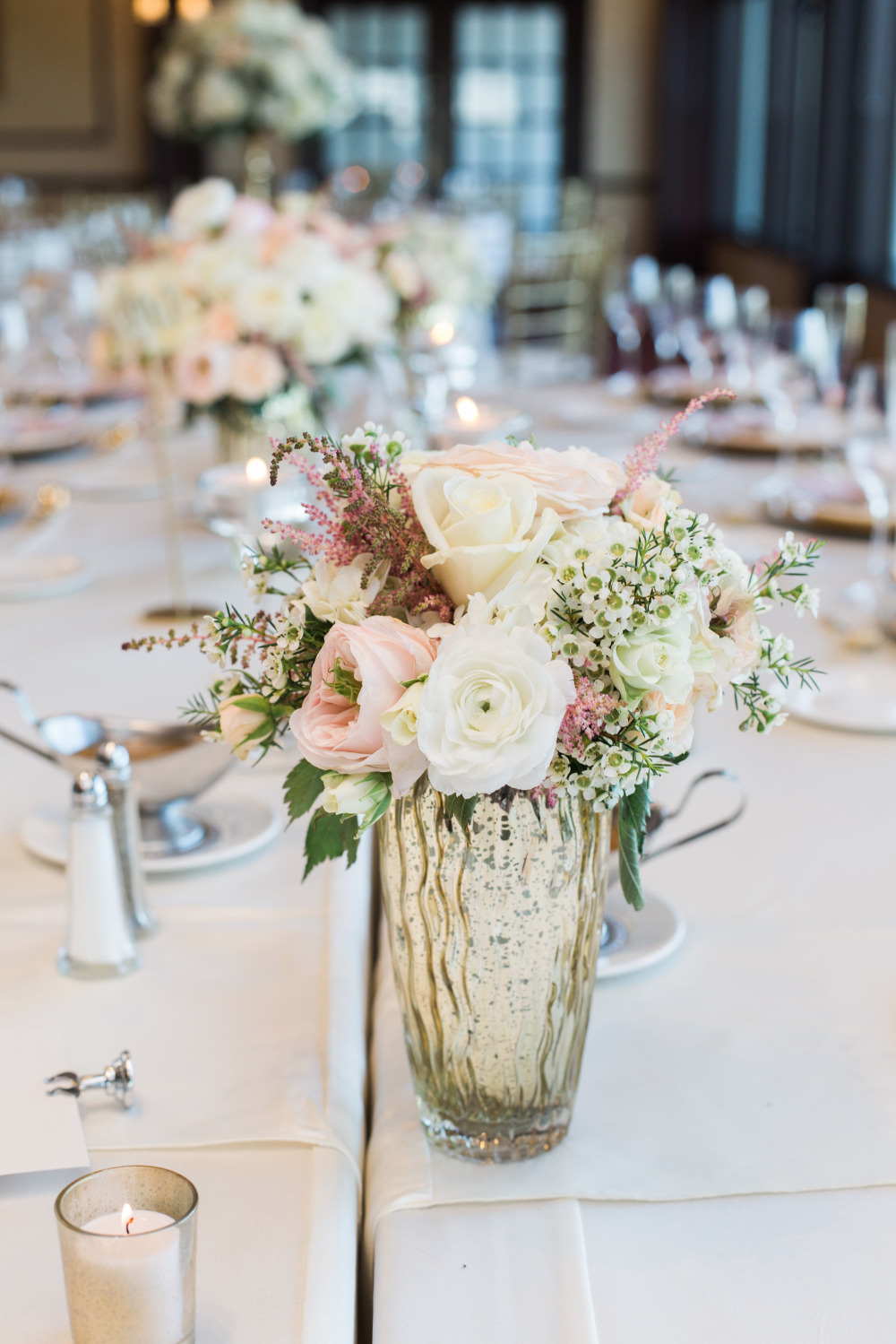 pink and white centerpiece in mercury glass
