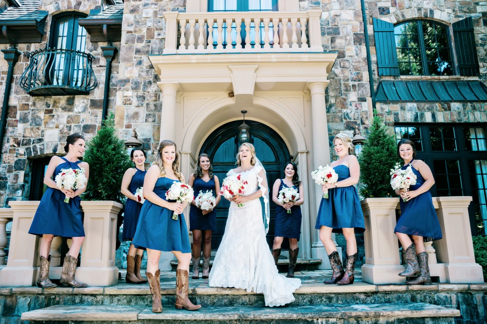 Bridesmaids in navy and cowgirl boots