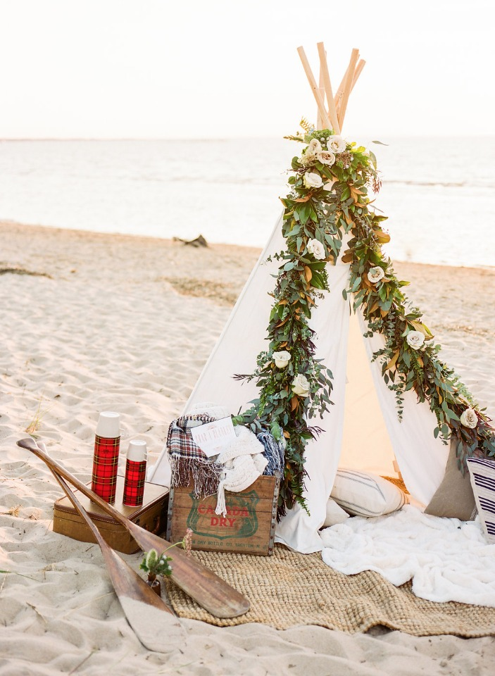 garland draped beach tent with vintage details