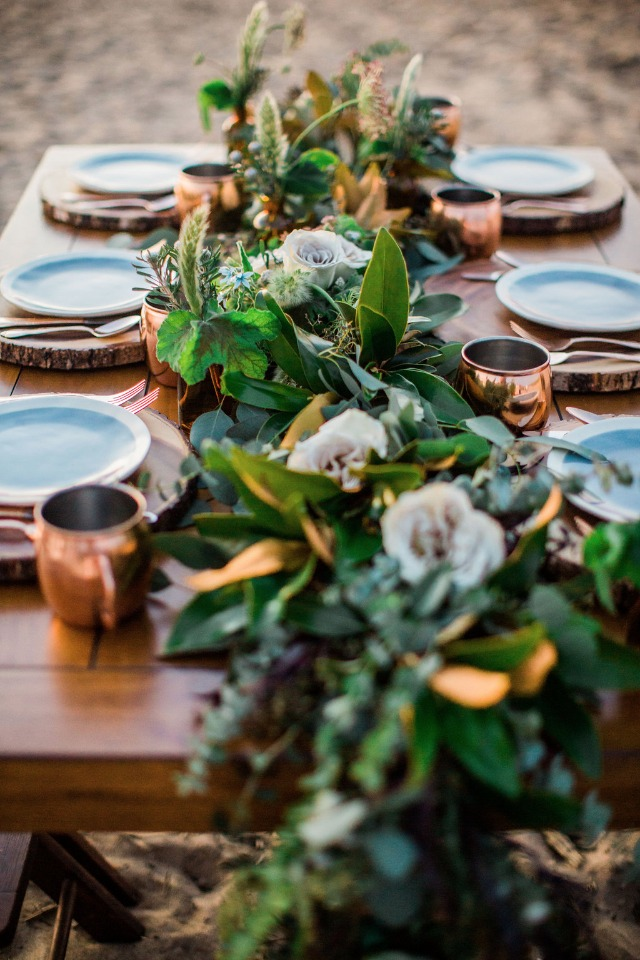 over grown greenery cascading garland table centerpiece