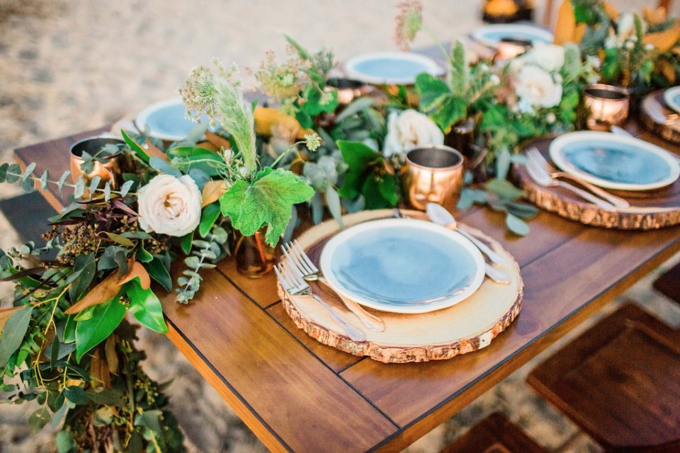 wooden slab chargers and greenery garland centerpiece table decor