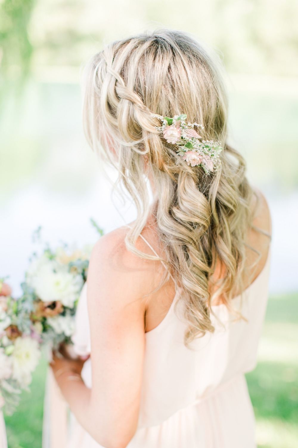 Floral accented bridesmaid hair