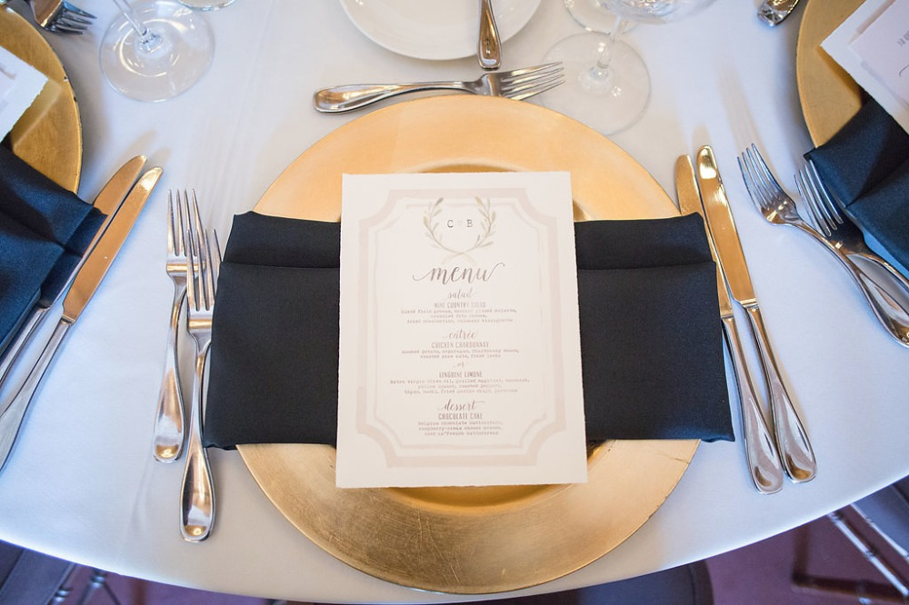 gold and navy place setting with romantic menu