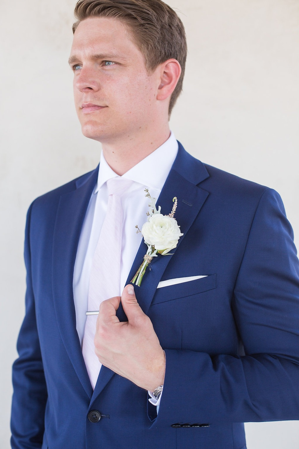 groom in blush pink tie and navy suit
